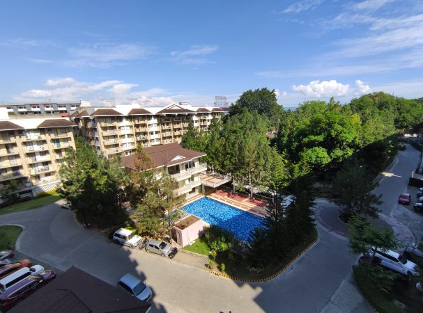 RFO Condo in Davao - Northpoint Davao - Camella Manors - Community Perspective with Pine Trees and Swimming Pool