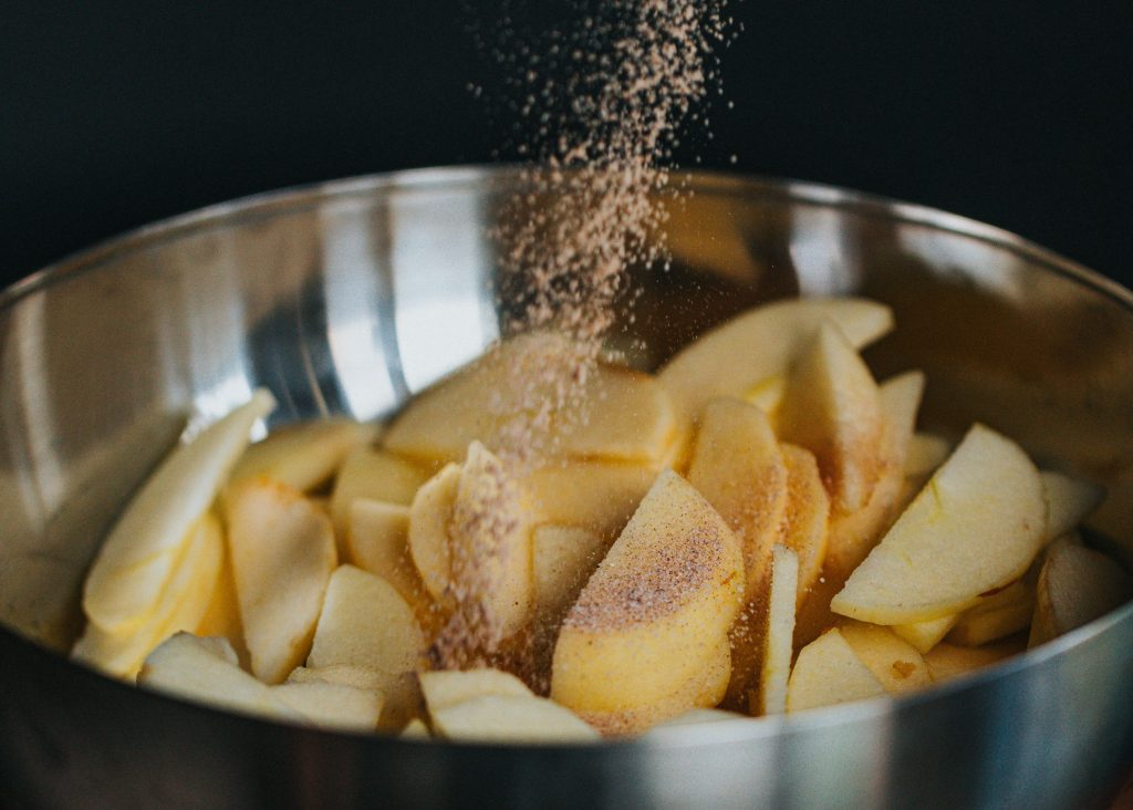 Ground Cinnamon on Apples   Essential Herbs and Spices